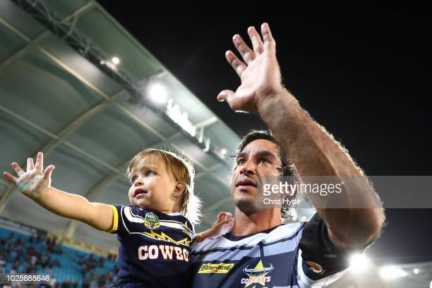 Johnathan Thurston of the Cowboys does a lap of honour with daughter Lillie after playing his last match during the round 25 NRL match between the...