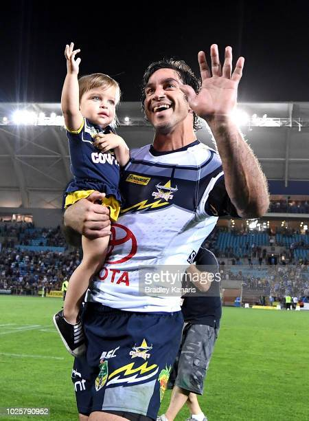Johnathan Thurston of the Cowboys farewells fans as he celebrates his last NRL match after the round 25 NRL match between the Gold Coast Titans and...