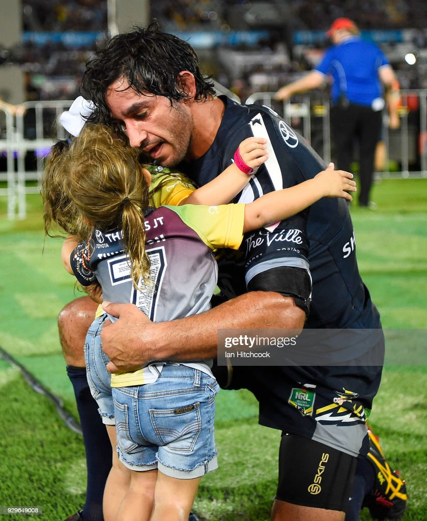 Johnathan Thurston of the Cowboys hugs his daughters Frankie and Charlie at the end of his 300th NRL match during the round one NRL match between the North Queensland Cowboys and the Cronulla Sharks at 1300SMILES Stadium on March 9, 2018 in Townsville, Australia.