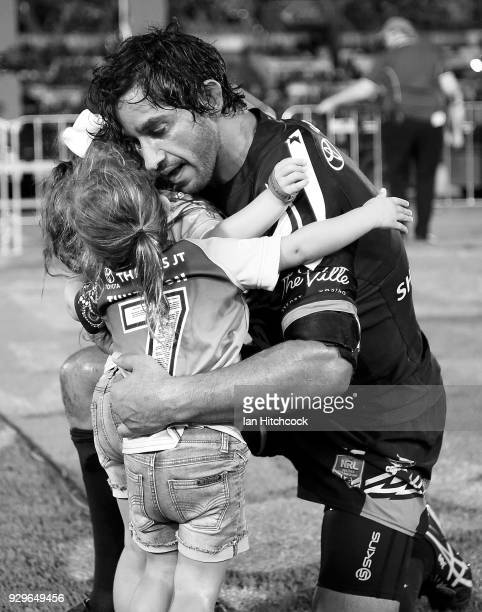 Johnathan Thurston of the Cowboys hugs his daughters Frankie and Charlie at the end of his 300th NRL match during the round one NRL match between the...