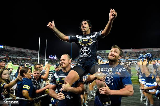 Johnathan Thurston of the Cowboys is chaired from the ground after playing his last home NRL match during the round 24 NRL match between the North...