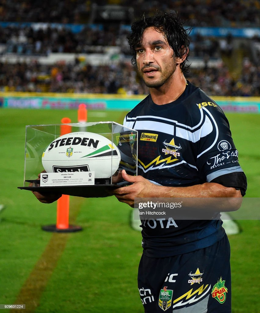 Johnathan Thurston of the Cowboys is presented with the game ball after finishing his 300th NRL game during the round one NRL match between the North Queensland Cowboys and the Cronulla Sharks at 1300SMILES Stadium on March 9, 2018 in Townsville, Australia.