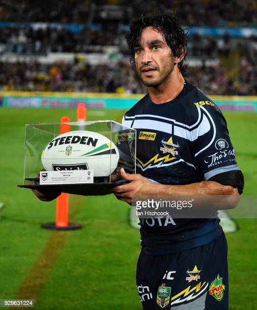 Johnathan Thurston of the Cowboys is presented with the game ball after finishing his 300th NRL game during the round one NRL match between the North...