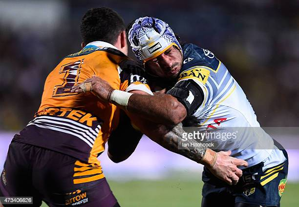 Johnathan Thurston of the Cowboys is tackled by Darius Boyd of the Broncos during the round 10 NRL match between the North Queensland Cowboys and the...