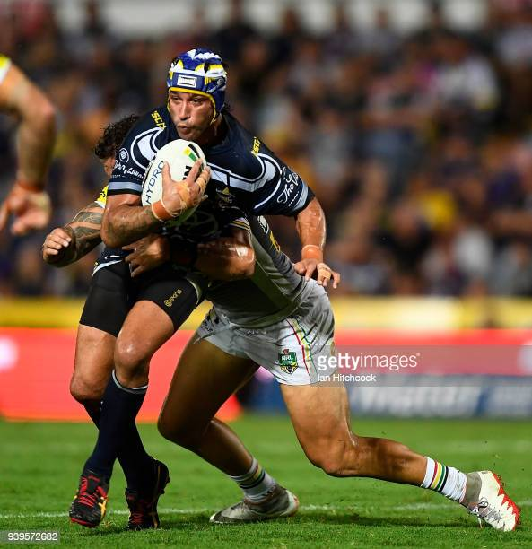 Johnathan Thurston of the Cowboys is tackled by James FisherHarris of the Panthers during the round four NRL match between the North Queensland...