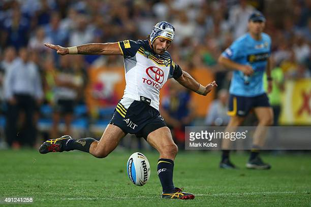 Johnathan Thurston of the Cowboys kicks a field goal in extratime to win the 2015 NRL Grand Final match between the Brisbane Broncos and the North...