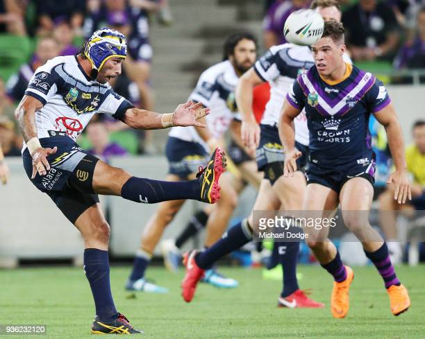Johnathan Thurston of the Cowboys kicks the ball during the round three NRL match between the Melbourne Storm and the North Queensland Cowboys at...