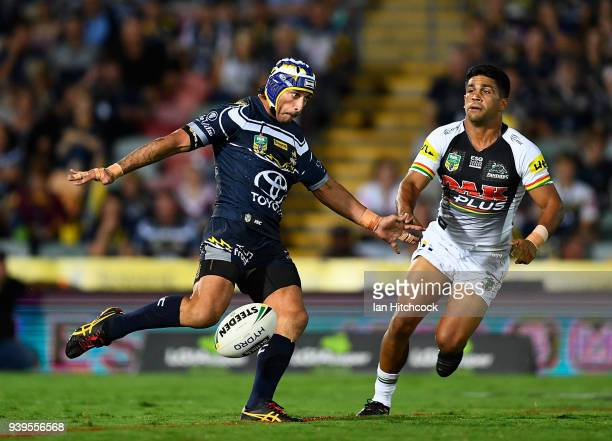 Johnathan Thurston of the Cowboys kicks the ball during the round four NRL match between the North Queensland Cowboys and the Penrith Panthers at...