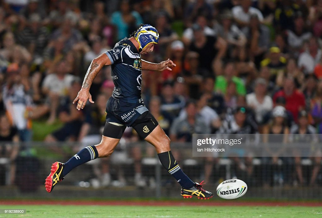 Johnathan Thurston of the Cowboys kicks the ball which lead to a try during the NRL trial match between the North Queensland Cowboys and the Wests Tigers at Barlow Park on February 17, 2018 in Cairns, Australia.