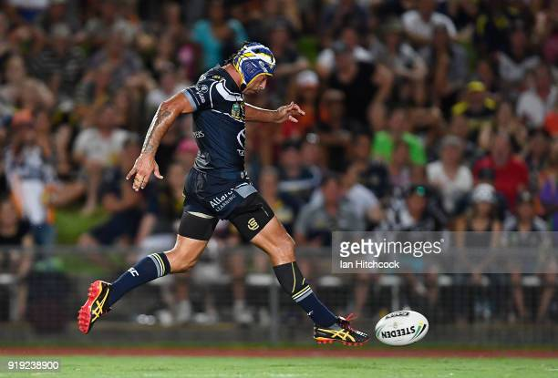 Johnathan Thurston of the Cowboys kicks the ball which lead to a try during the NRL trial match between the North Queensland Cowboys and the Wests...