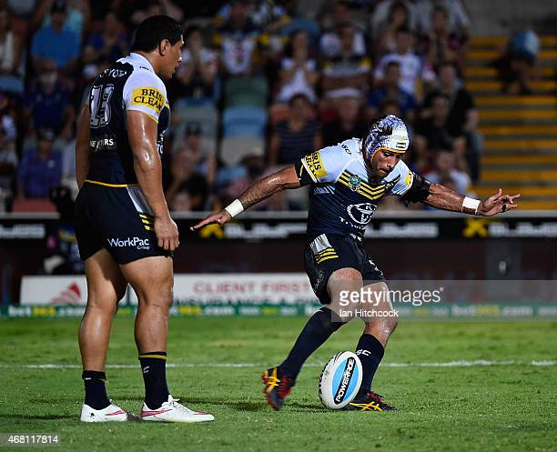 Johnathan Thurston of the Cowboys kicks the winning field goal during the round four NRL match between the North Queensland Cowboys and the Melbourne...