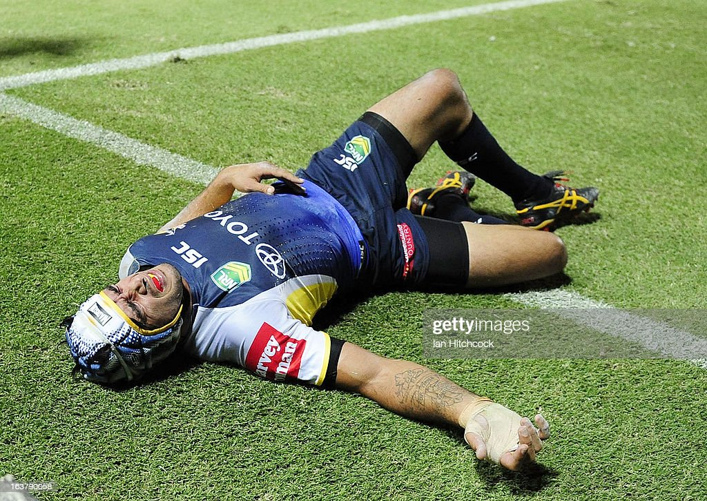 Johnathan Thurston of the Cowboys lays injured during the round two NRL match between the North Queensland Cowboys and the Melbourne Storm at 1300SMILES Stadium on March 16, 2013 in Townsville, Australia.