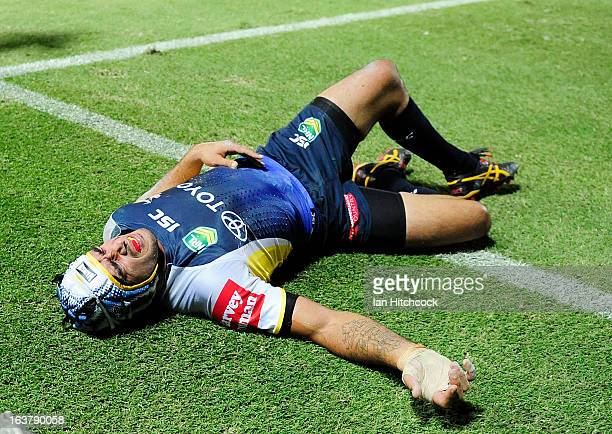 Johnathan Thurston of the Cowboys lays injured during the round two NRL match between the North Queensland Cowboys and the Melbourne Storm at...