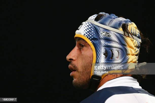 Johnathan Thurston of the Cowboys looks at the goal posts as he prepares to kick for goal during the round eight NRL match between the Parramatta...