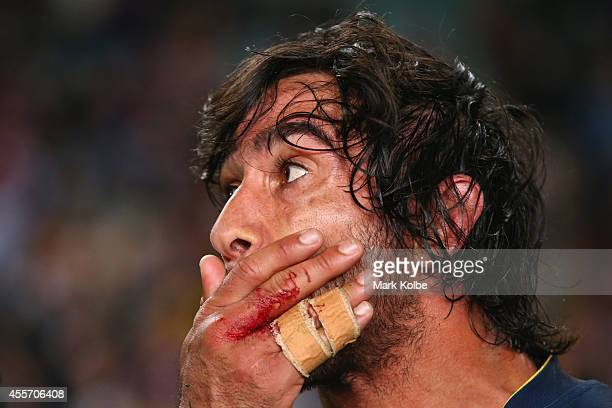 Johnathan Thurston of the Cowboys looks dejected after defeat during the 1st NRL Semi Final match between the Sydney Roosters and the North...