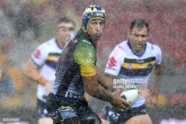 Johnathan Thurston of the Cowboys looks to pass during the NRL trial match and Jonathan Thurston/Cameron Smith Testimonial match between the...