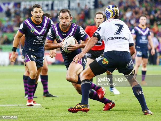 Johnathan Thurston of the Cowboys looks to tackle Cameron Smith of the Storm during the round three NRL match between the Melbourne Storm and the...