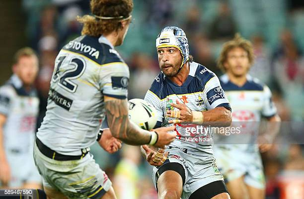 Johnathan Thurston of the Cowboys passes during the round 23 NRL match between the Sydney Roosters and the North Queensland Cowboys at Allianz...