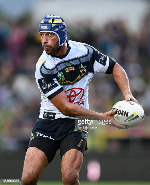 Johnathan Thurston of the Cowboys passes the ball during the round 16 NRL match between the South Sydney Rabbitohs and the North Queensland Cowboys...