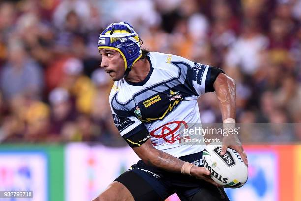 Johnathan Thurston of the Cowboys passes the ball during the round two NRL match between the Brisbane Broncos and the North Queensland Cowboys at...