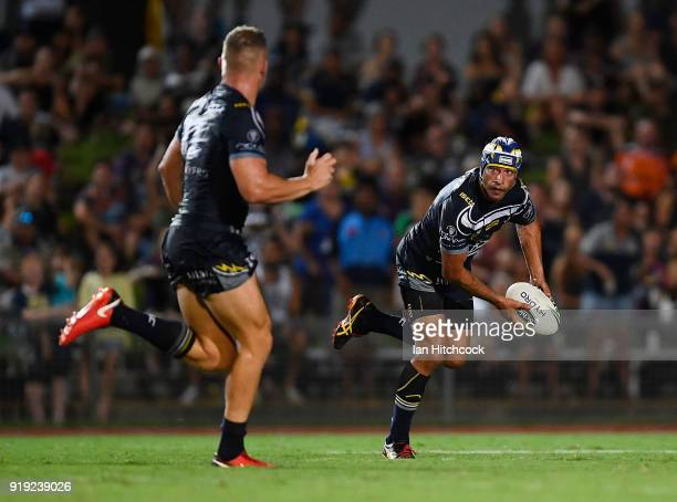 Johnathan Thurston of the Cowboys passes the ball to Coen Hess of the Cowboys during the NRL trial match between the North Queensland Cowboys and the...