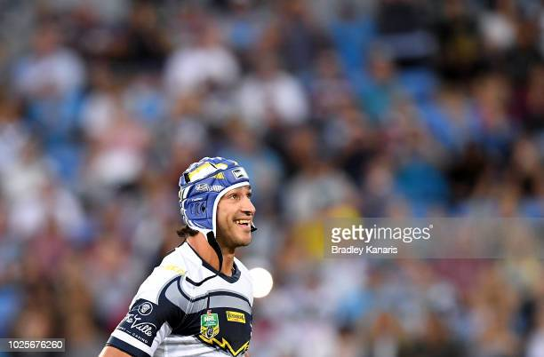 Johnathan Thurston of the Cowboys runs out onto the field of play for his last NRL match during the round 25 NRL match between the Gold Coast Titans...