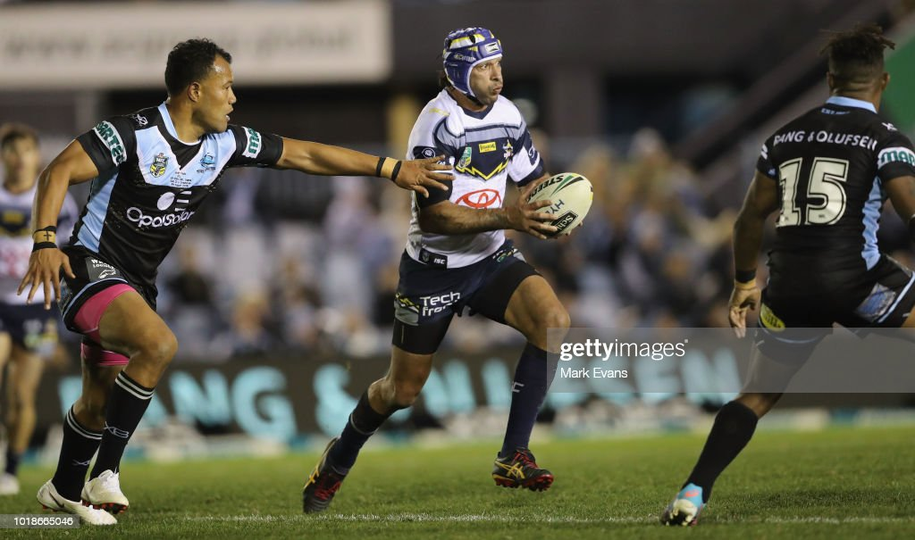 Johnathan Thurston of the Cowboys runs the ball during the round 23 NRL match between the Cronulla Sharks and the North Queensland Cowboys at Southern Cross Group Stadium on August 18, 2018 in Sydney, Australia.