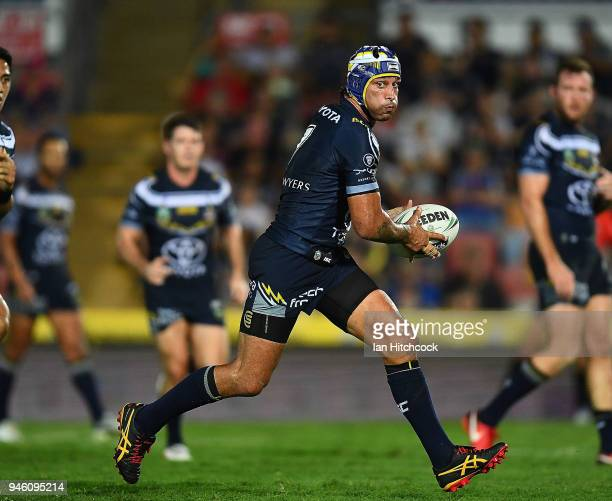 Johnathan Thurston of the Cowboys runs the ball during the round six NRL match between the North Queensland Cowboys and the Canterbury Bulldogs at...