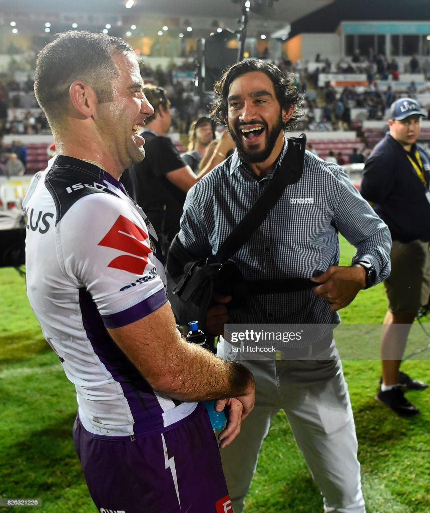 Johnathan Thurston of the Cowboys shares a laugh with Cameron Smith of the Storm after the end of the round 22 NRL match between the North Queensland Cowboys and the Melbourne Storm at 1300SMILES Stadium on August 4, 2017 in Townsville, Australia.