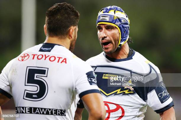 Johnathan Thurston of the Cowboys speaks to Antonio Winterstein of the Cowboys during the round three NRL match between the Melbourne Storm and the...