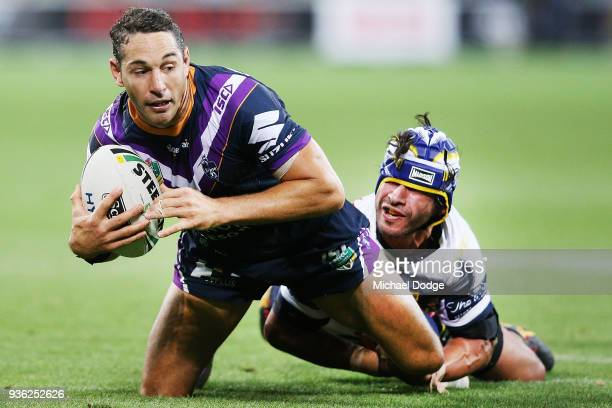 Johnathan Thurston of the Cowboys tackles Billy Slater of the Storm during the round three NRL match between the Melbourne Storm and the North...