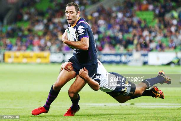 Johnathan Thurston of the Cowboys tackles Cameron Smith of the Storm during the round three NRL match between the Melbourne Storm and the North...