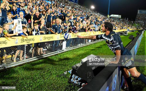 Johnathan Thurston of the Cowboys throws his headgear to the crowd at the end of his 300th NRL game during the round one NRL match between the North...