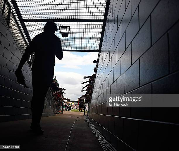 Johnathan Thurston of the Cowboys walks down the tunnel onto the field at the start of the round 17 NRL match between the South Sydney Rabbitohs and...