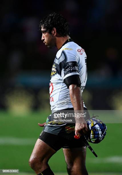 Johnathan Thurston of the Cowboys walks from the field looking dejected after losing the round 16 NRL match between the South Sydney Rabbitohs and...