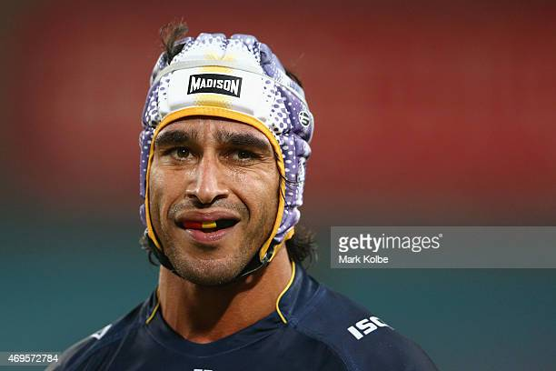 Johnathan Thurston of the Cowboys watches on as he waits for the video referee's decision during the round six NRL match between the South Sydney...