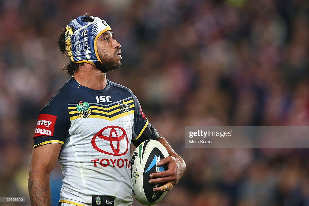 Johnathan Thurston of the Cowboys watches the big screen as he waits as the video referee reviews a try during the 1st NRL Semi Final match between the Sydney Roosters and the North Queensland Cowboys at Allianz Stadium on September 19, 2014 in Sydney, Australia.