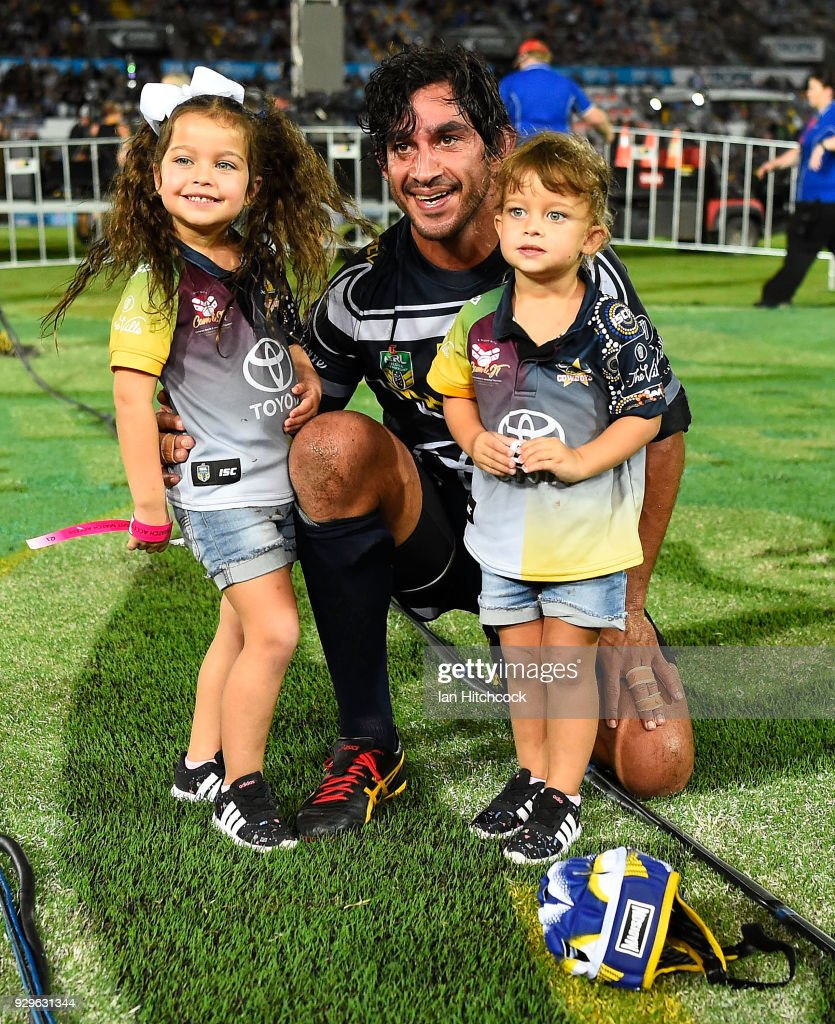 Johnathan Thurston of the Cowboys with his daughters Frankie and Charlie at the end of his 300th NRL match during the round one NRL match between the North Queensland Cowboys and the Cronulla Sharks at 1300SMILES Stadium on March 9, 2018 in Townsville, Australia.