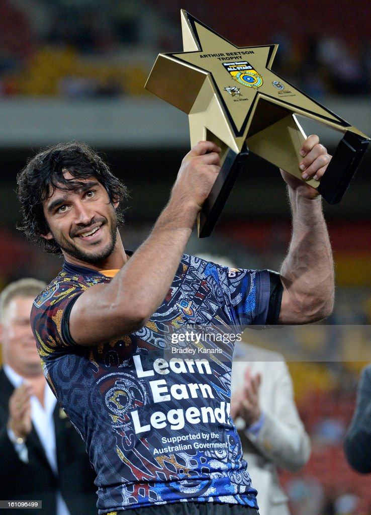 Johnathan Thurston of the Indigenous All Stars celebrates victory as he holds up the Arthur Beetson trophy after the NRL All Stars Game between the Indigenous All Stars and the NRL All Stars at Suncorp Stadium on February 9, 2013 in Brisbane, Australia.