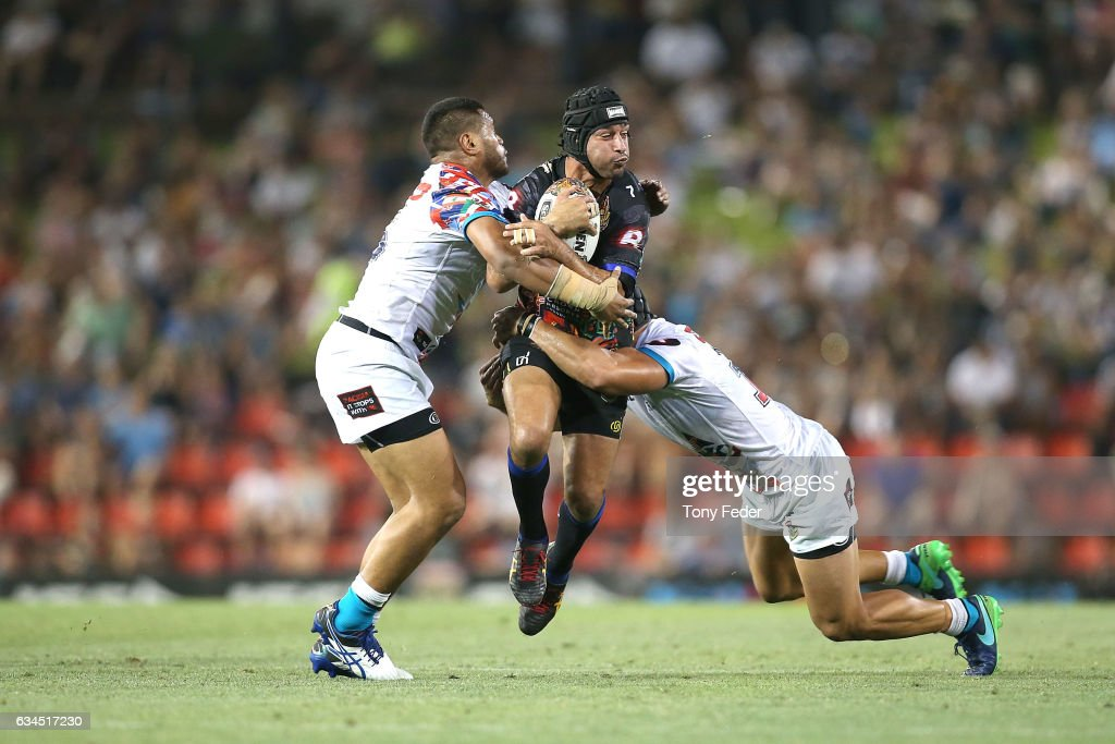 Johnathan Thurston of the Indigenous All Stars is tackled during the NRL All Stars match between the 2017 Harvey Norman All Stars and the NRL World All Stars at McDonald Jones Stadium on February 10, 2017 in Newcastle, Australia.