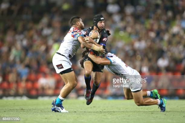 Johnathan Thurston of the Indigenous All Stars is tackled during the NRL All Stars match between the 2017 Harvey Norman All Stars and the NRL World...