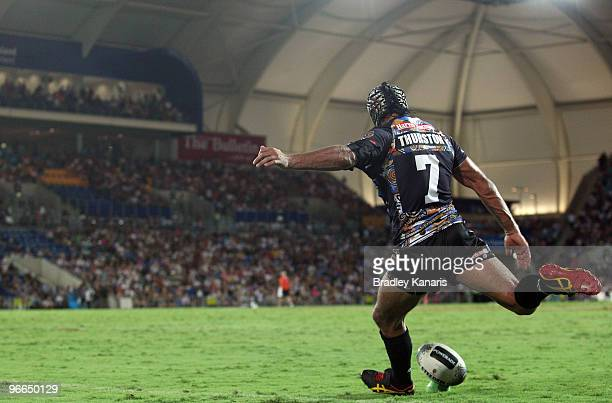 Johnathan Thurston of the Indigenous All Stars team kicks for goal during the Indigenous All Stars and the NRL All Stars match at Skilled Park on...