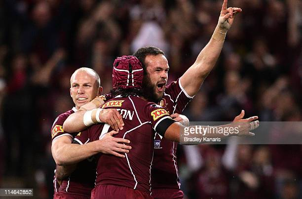 Johnathan Thurston of the Maroons and Nate Myles celebrate a try during game one of the ARL State of Origin series between the Queensland Maroons and...