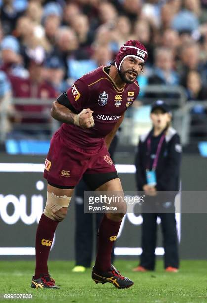 Johnathan Thurston of the Maroons celebrates after kicking the winning conversion during game two of the State Of Origin series between the New South...