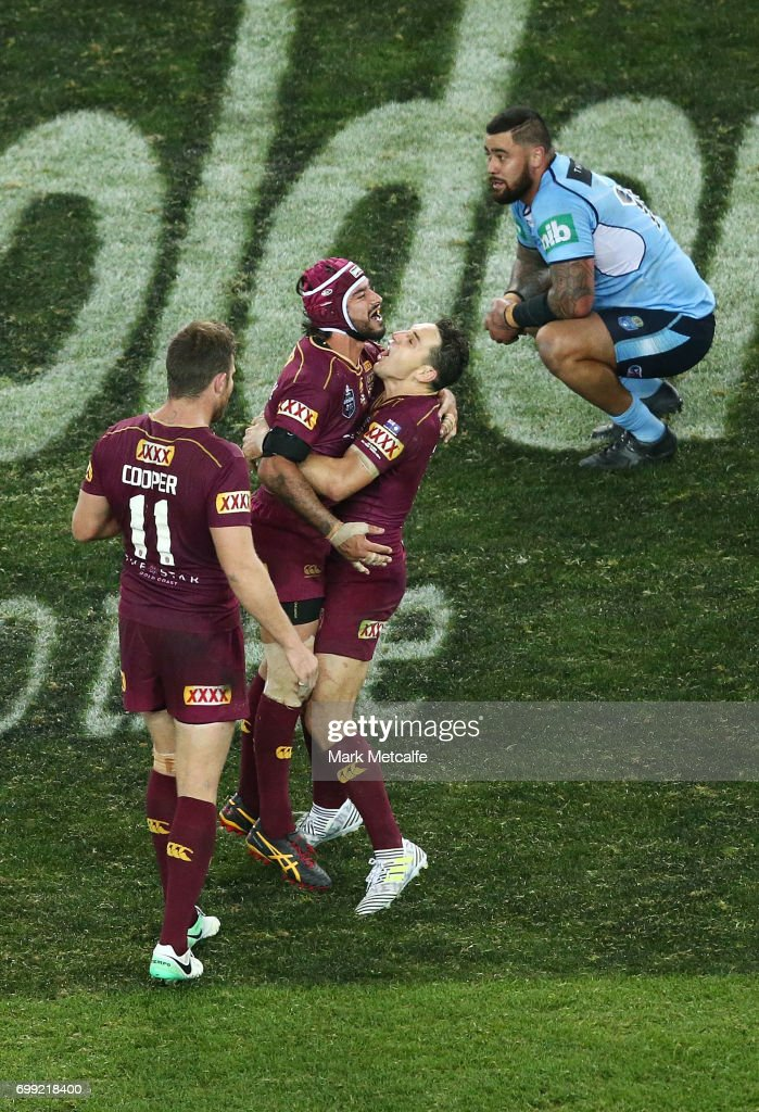 Johnathan Thurston of the Maroons celebrates victory with team mates Billy Slater and Gavin Cooper during game two of the State Of Origin series between the New South Wales Blues and the Queensland Maroons at ANZ Stadium on June 21, 2017 in Sydney, Australia.