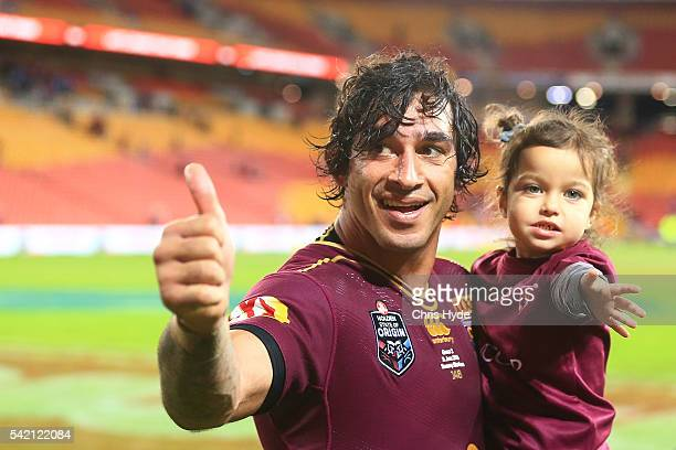 Johnathan Thurston of the Maroons celebrates winning with his daughter during game two of the State Of Origin series between the Queensland Maroons...
