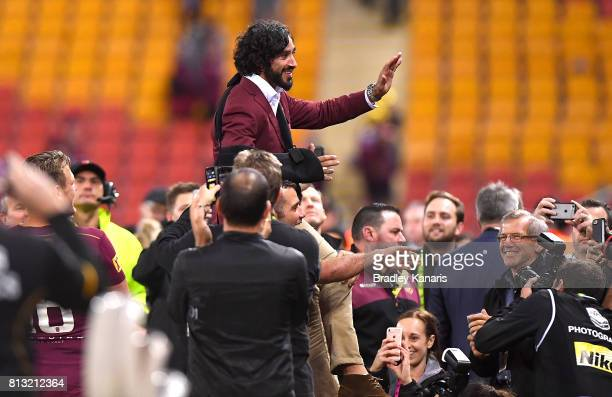 Johnathan Thurston of the Maroons is chaired off after Queensland win game three of the State Of Origin series between the Queensland Maroons and the...