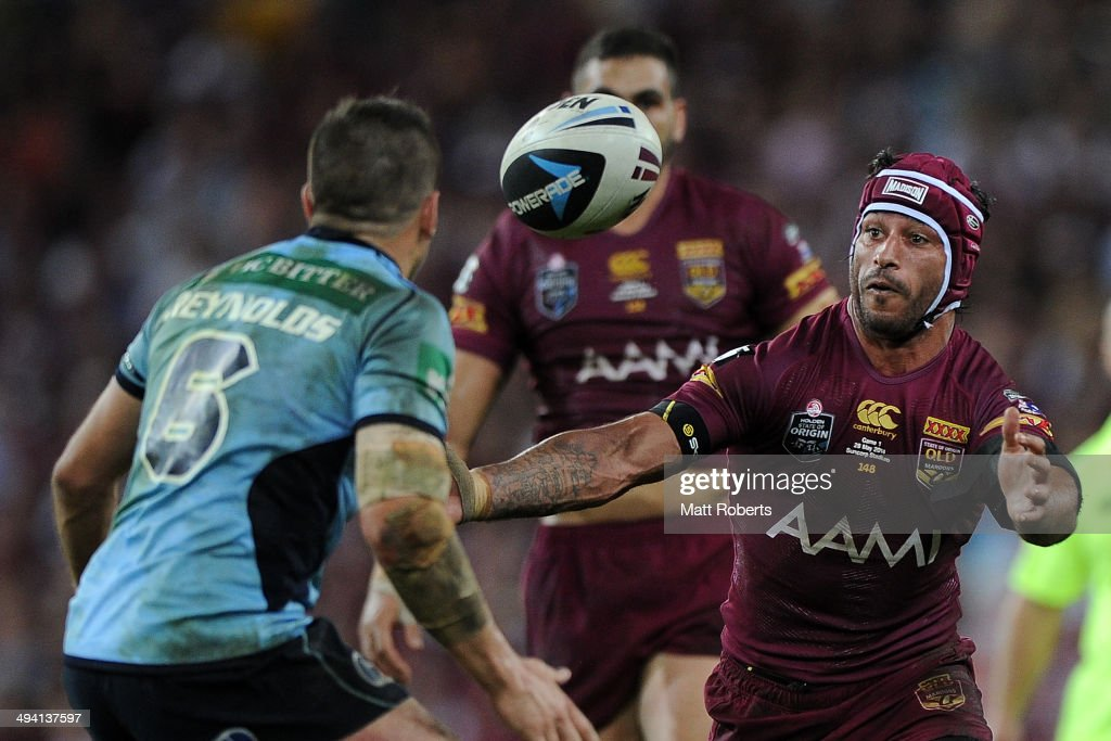Johnathan Thurston of the Maroons knocks on during game one of the State of Origin series between the Queensland Maroons and the New South Wales Blues at Suncorp Stadium on May 28, 2014 in Brisbane, Australia.