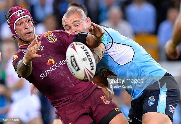 Johnathan Thurston of the Maroons offloads during game two of the State Of Origin series between the Queensland Maroons and the New South Wales Blues...