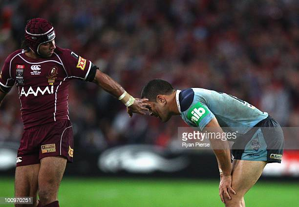 Johnathan Thurston of the Maroons speaks to Jarryd Hayne of the Blues after he threw a pass wide during game one of the ARL State of Origin series...